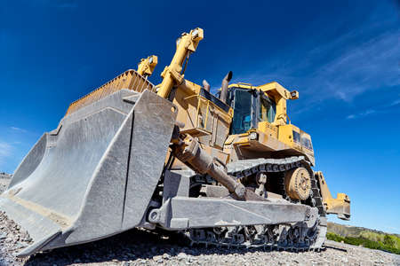 heavy equipment: construction heavy equipment large bulldozer on jobsite closeup Stock Photo