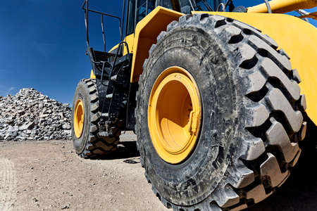 heavy equipment: Construction heavy equipment loader and bucket on jobsite with gravel and rocks Stock Photo