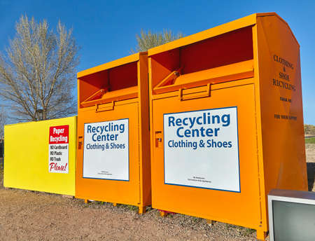 recycling center: Recycling center collection bins for paper clothing disposal waste management Stock Photo