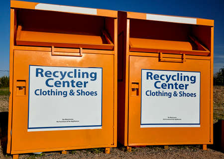 recycling center: Recycling center collection bins for clothing disposal industry and waste management Stock Photo