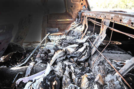 the occupant: automobile car truck interior fire damage after highway collision Stock Photo