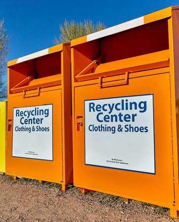 recycling center: Recycling center collection bins for clothing and waste disposal industry and waste management Stock Photo