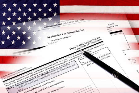 naturalization: Immigration naturalization application and USA flag concept of citizenship and American patriotism.