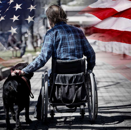 america soldiers: Man on wheelchair with guide dog concept USA veteran concept photograph patriotism and sacrifice