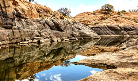 aquifer: professional high resolution landscape photograph of a scenic granite mountain lake showing classic composition and lighting fundamentals and non intrusive post processing techniques