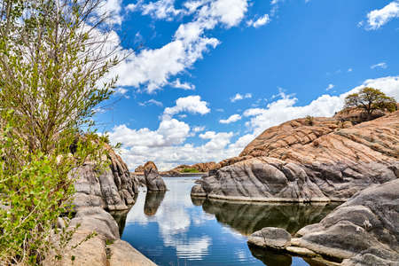 fundamentals: professional high resolution landscape photograph of a scenic granite mountain lake showing classic composition and lighting fundamentals and non intrusive post processing techniques