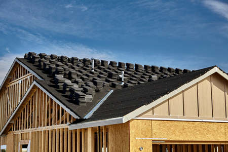 roof framing: Home building industry double gable roof construction