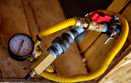 residential home: Construction building industry residential home gas valve and gauge closeup