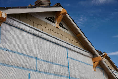 gable: Home building industry gable roof slope transition and stucco prep Stock Photo