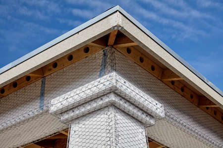 stucco house: Home building industry house beam and column stucco prep detail
