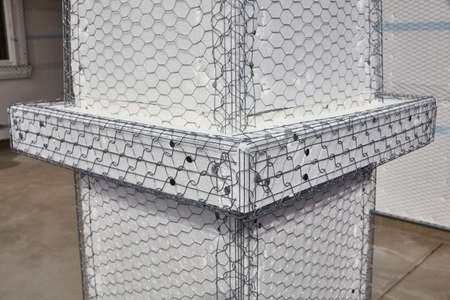 stucco house: Home building industry house post column ledger stucco mesh detail Stock Photo