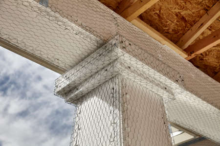 stucco house: Home building industry house beam to column stucco mesh detail