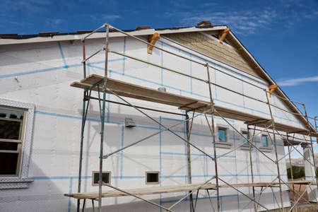 stucco house: Home building industry house scaffolding for stucco and insulation foam Stock Photo