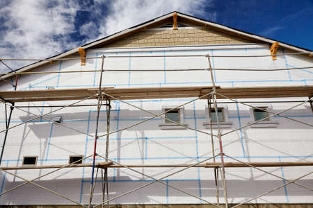 stucco house: Home building industry house scaffolding for stucco insulation foam