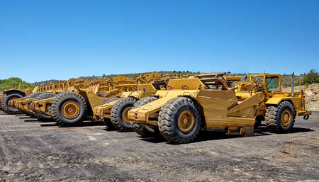 scrapers: Heavy equipment wheeled motor scrapers Stock Photo
