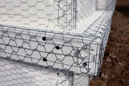 stucco house: Home building industry house post ledger stucco mesh closeup
