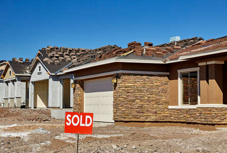 sold sign: Construction industry new home for sale with sold sign