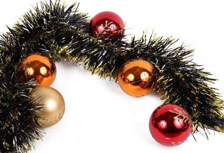 diferent: some christmas balls in diferent colors with a wreath