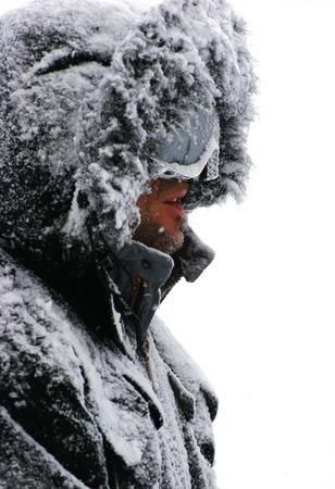 anorak: man in black looking the snow