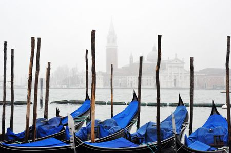 Venice gondolas in fog with grand canal in background