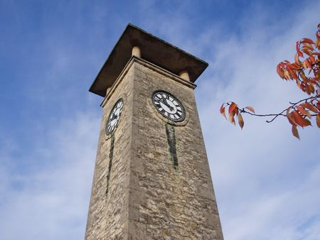 Nailsworth clock tower with sky background and branch