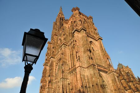lamp post: Strasbourg cathedral with lamp post and sky