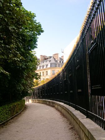 Curved path with fence in Luxembourg Garden