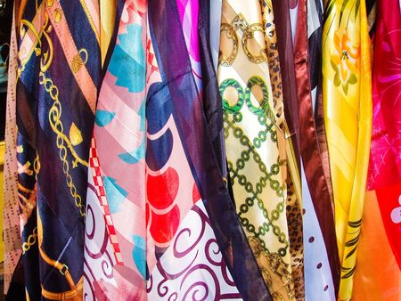 scarves: Variety of multicolored hanging scarves in Paris France