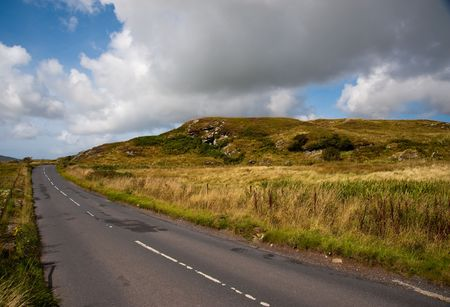 Road and hill on the Isle of Islay Stock Photo