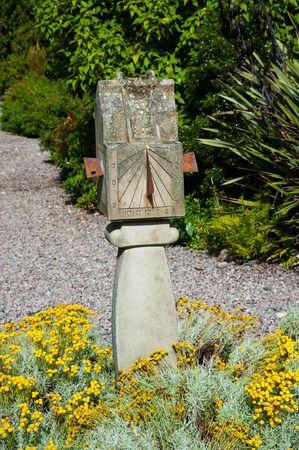 Old sundial in a garden Stock Photo
