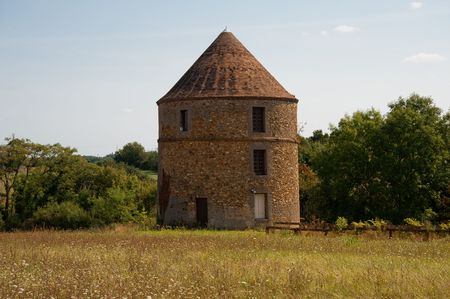 Round brick building with conical roof