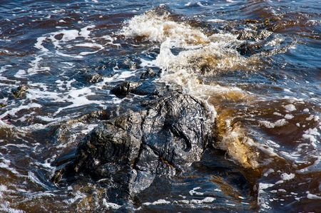 Water covered rocks in highland loch Stock Photo