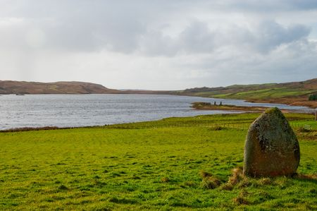 Standing stone near Eilean Mor Loch Finlaggan, centre of the Lordship of the Isles photo