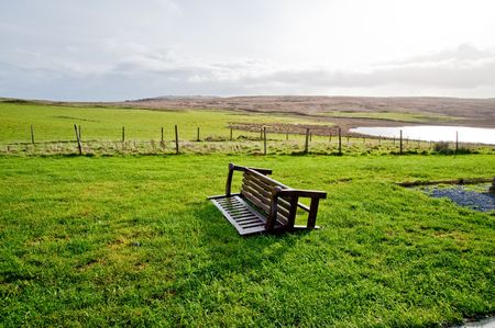 overturned: Overturned bench on the isle of Islay Stock Photo