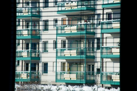 Apartment building seen through blinds photo