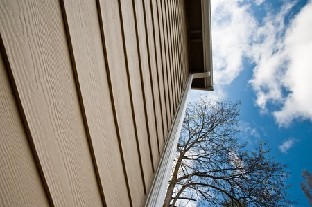cladding: Downspout and siding on an urban house