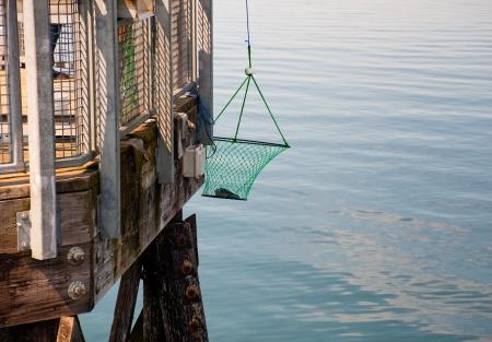 crab pot: Pier and crab pot, Kayak Point Stock Photo