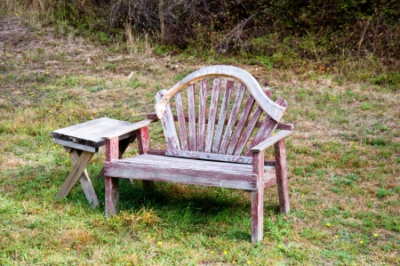 Old bench and table in a field Stock Photo - 17861250