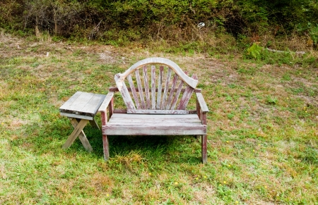 Old bench and table in a field Stock Photo - 17861230