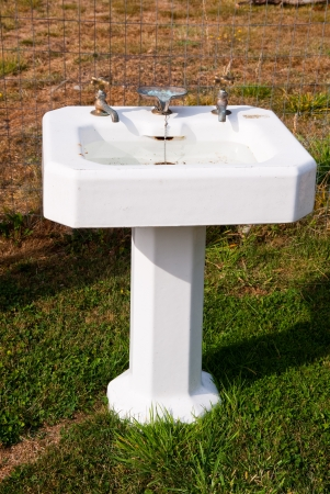 Antique pedestal sink Stock Photo - 17861322