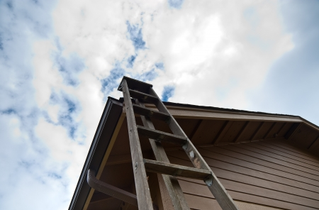 Ladder leaning against a house Stock Photo - 17861258