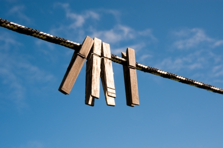 clench: Clothespins on a line in a yard