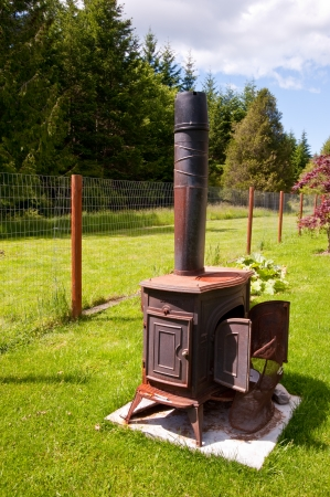 outdoor fireplace: Wood burning stove outside