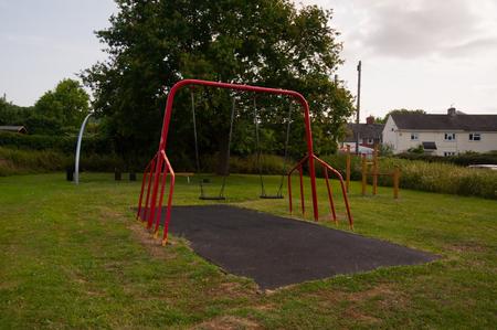 Swings on a playground Standard-Bild