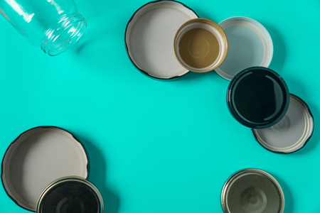 Recycling glass jar lids for reuse of single use items; Zero no waste recycle program campaigns; Recyclable concept on blank empty copyspace, text room space for copy on horizontal cyan background.