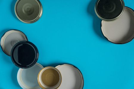 Recycling glass jar lids; Reuse of single use items; Zero no waste recycle program campaigns; Recyclable concept on blank empty copyspace, text room space for copy on horizontal light blue background.
