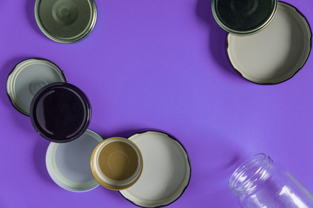 Recycling glass jar lids for reuse of single use items; Zero no waste recycle program campaigns; Recyclable concept on blank empty copyspace, text room space for copy on horizontal purple background.