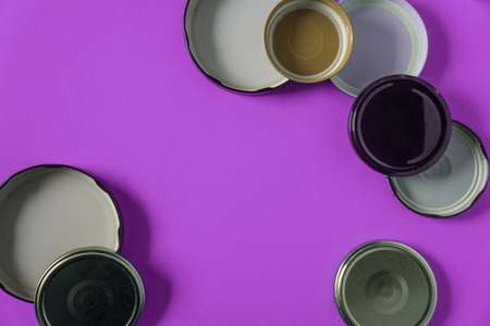 Recycling glass jar lids for reuse of single use items; Zero no waste recycle program campaigns; Recyclable concept on blank empty copyspace, text room space for copy on horizontal pink background.