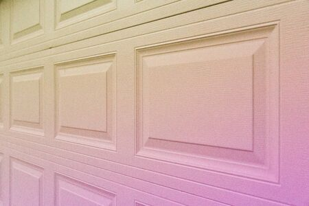 Trendy pink yellowish holographic gradient garage door paneling. Colorful background with linear lines & square / rectangular panels that show close up perspective. Holo 90 / 80 style squared shapes