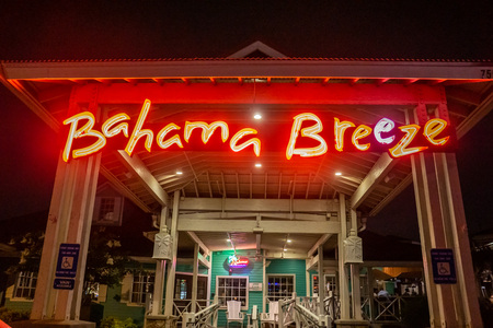 Kennesaw, GA - July 12th 2019: Exterior photos at night of Bahama Breeze - Tropical island beach themed American chain restaurant with Caribbean inspired seafood. Outside of building.